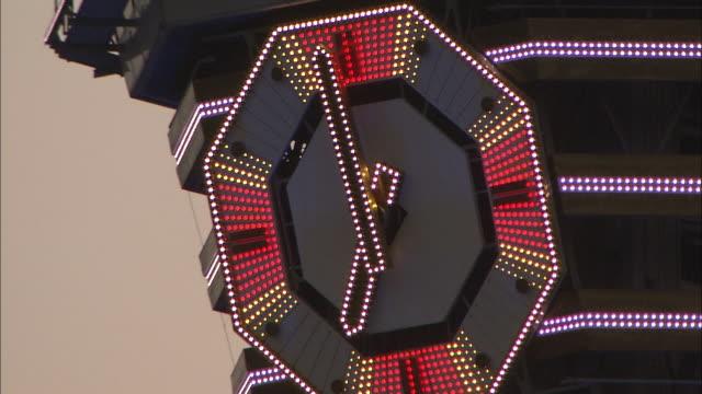 great clock of tsutenkaku tower, osaka, japan - orologio video stock e b–roll