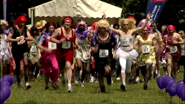 great drag race held in aid of charity england london highbury ext group of men wearing wigs leotards and tights lined up for start of great drag... - gymnastikanzug stock-videos und b-roll-filmmaterial