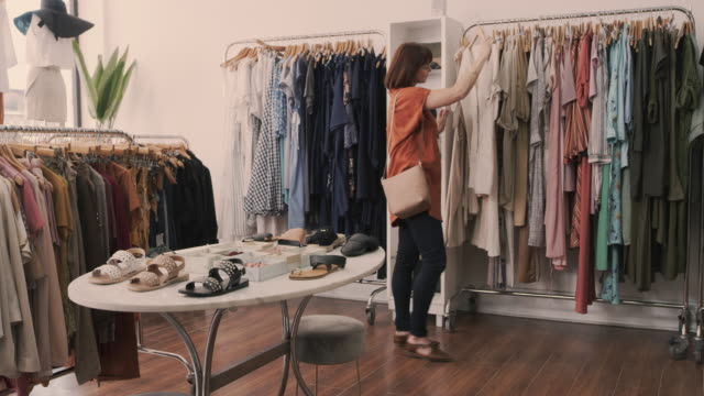 great fashion at great service - clothes rail stock videos & royalty-free footage