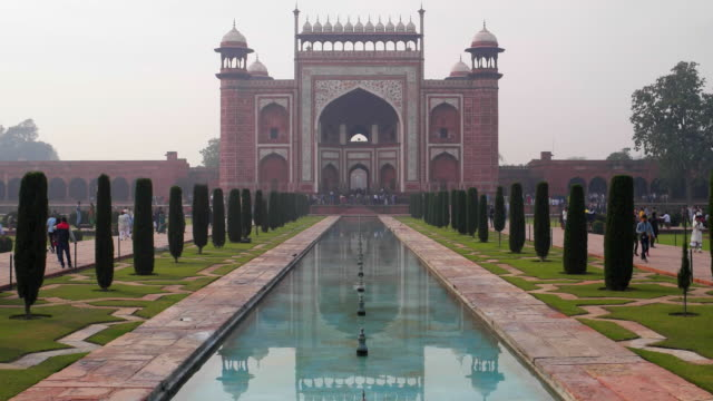 Great gate (Darwaza-i rauza); main entrance to the Taj Mahal tomb, reflected in the blue waters of the pool