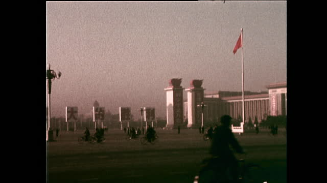 zo great hall of the people in tiananmen square with flag; 1972 - communist flag stock videos & royalty-free footage