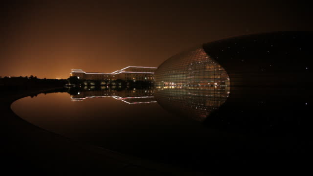 WS Great Hall of the People next to National Grand Theater at night / Beijing, China