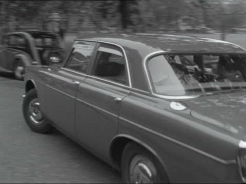 london: westminster: rochester row: gv police station av sign - 'rochester row' car past r-l - mary manson under blanket in back seat neg 16mm itn - blanket stock videos & royalty-free footage