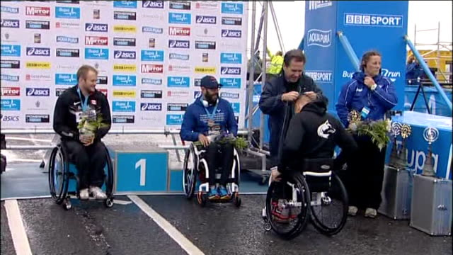 finish / medal ceremony and intvws GVs More men's race finishers / Women's wheelchair race winners at medal presentation ceremony Shelly Woods in...