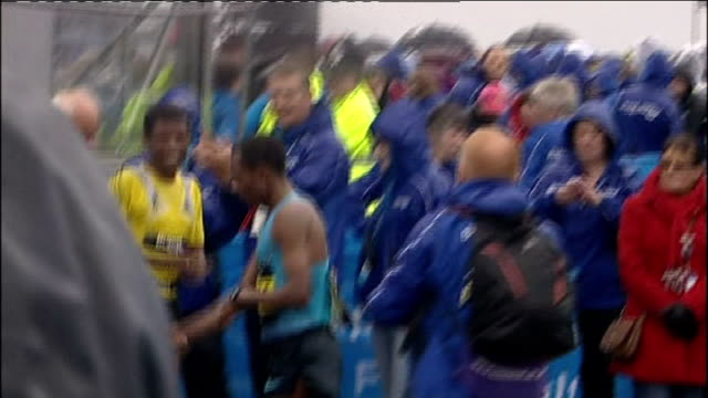 finish / medal ceremony and intvws Men's finish with Kenenisa Bekele winning just ahead of Mo Farah in second place / Haile Gebrselassie finishing in...