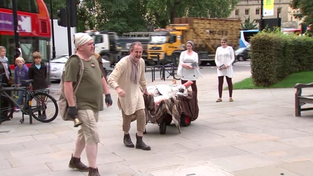 great plague of london procession england london ext man in plague mask / woman in cart pretending to be plague victim / men pulling cart of plague... - mask stock videos & royalty-free footage