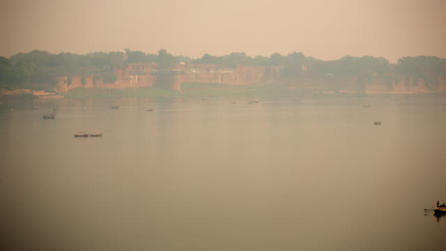 a great river flows past a fort on the opposite sandbank - tree fort stock videos & royalty-free footage