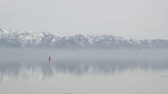 Great Salt Lake covered in fog with mountains in background