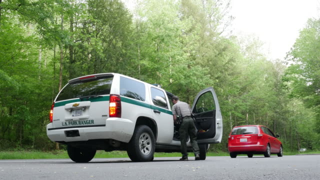Great Smoky Mountains National Park ranger wrtiing a ticket to a driver