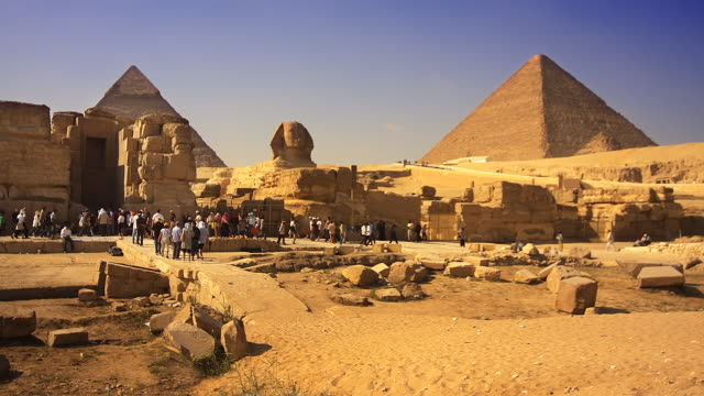 t/l, ws, great sphinx of giza and pyramids, egypt - tourist stock videos & royalty-free footage