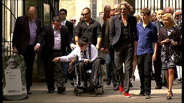 great train robber ronnie biggs death; 8.8.2013 - r08081310 england: london: highgate: ext ronnie biggs along in wheelchair at service for fellow... - highgate stock videos & royalty-free footage