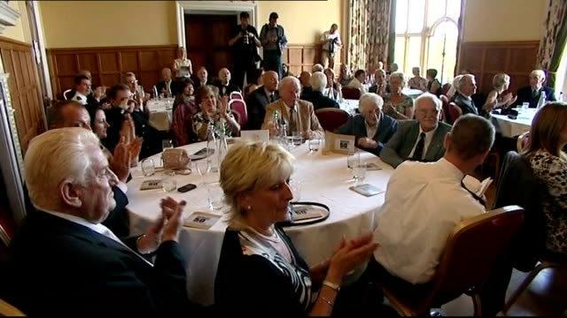 police commemoration event england oxfordshire witney eynsham hall photography** people sitting around tables attending event / keith milner being... - oxfordshire stock videos & royalty-free footage
