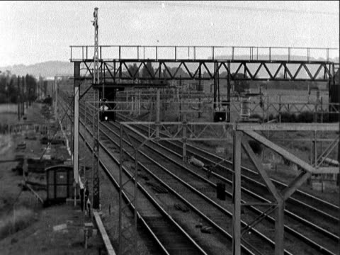 buckinghamshire cheddington bridego railway bridge empty track showing signal gantry ms line seen from road pan rl to pond ws train engine ws... - stealing stock videos & royalty-free footage