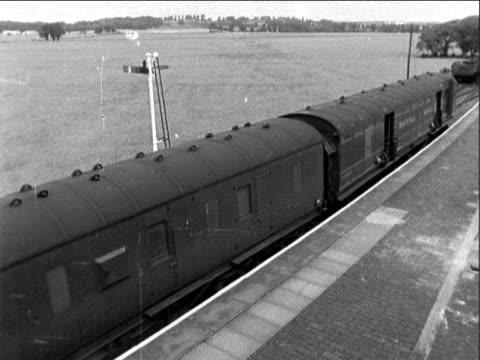 buckinghamshire cheddington bridego railway bridge steam train along tracks over railway bridge ws stationary diesel engine in station ws ransacked... - stealing stock videos & royalty-free footage