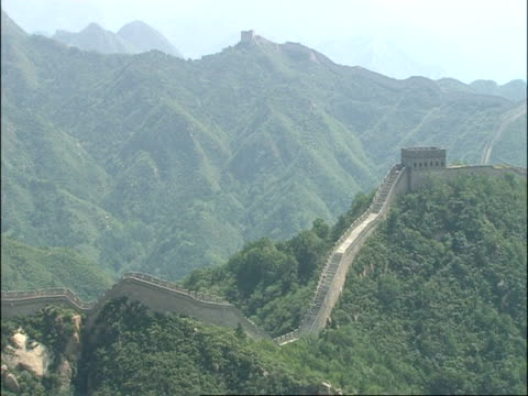 WA Great Wall of China in midst of forested mountains, Badaling, China