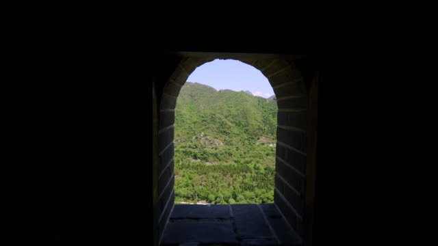 great wall of china on green mountain against sky seen from window - beijing, china - great wall of china stock videos & royalty-free footage