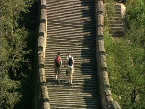 wa great wall of china with tourists walking, mutianyu, china - mutianyu stock videos & royalty-free footage