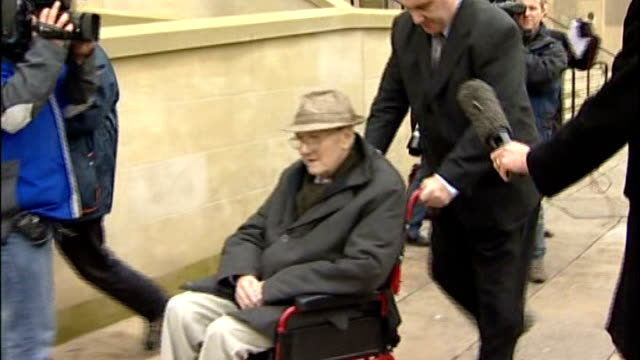 bolton ext / day shaun greenhowdge pushing george greenhowdge along outside court in wheelchair - bolton greater manchester stock videos and b-roll footage