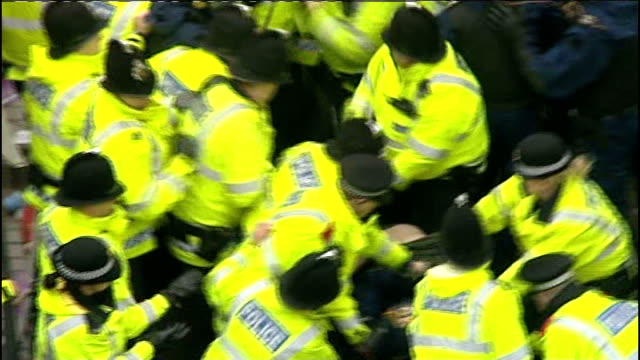 greater manchester bolton ext police officers and riot police struggling with protestors as making arrests english defence league edl supporters... - bolton greater manchester stock videos and b-roll footage