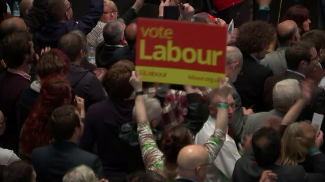 greater manchester: oldham west and royton contituency: ext jeremy corbyn mp hugging and congratulating victorious labour candidate jim mcmahon and... - 英国労働党点の映像素材/bロール