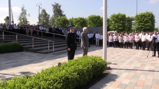 greater manchester police chief constable ian hopkins along with hundreds of officers and support staff observe a minute's silence at their... - police chief stock videos and b-roll footage