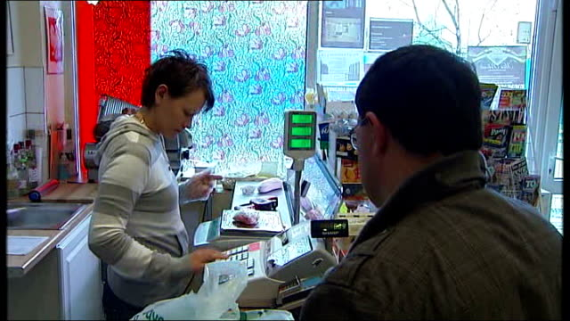 greater manchester rochdale int bernadette sysa serving customer in shop polish foodstuffs on shop shelf pan customer at till - rochdale england stock videos & royalty-free footage
