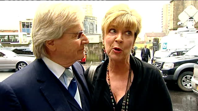 greater manchester salford cathedral ext sue nicholls arriving at memorial service with husband mark eden and antony cotton andrew whyment arriving... - ウィリアム・ローチ点の映像素材/bロール