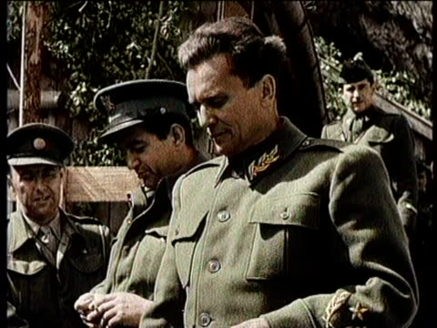 no audio / greatest headlines of the century /josip tito takes over / footage of tito's yugoslav partisan uniformed soldiers men and women / marching... - 旧ユーゴスラビア点の映像素材/bロール