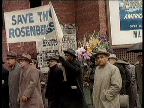 greatest headlines of the century / rosenbergs executed / demonstrators marching in a circle to save julius and ethel rosenberg from execution /... - electric chair stock videos & royalty-free footage