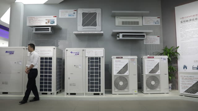 Gree Electric Appliances Ltd commercial air conditioner units sit on display at the company's showroom in Zhuhai China on Wednesday March 28 2018