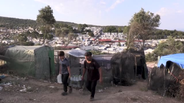 greece announced on saturday another extension of the coronavirus lockdown in its crowded migrant camps - refugee camp stock videos & royalty-free footage