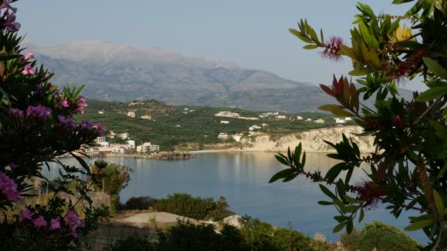 greece crete flowers coastal view - 不在点の映像素材/bロール