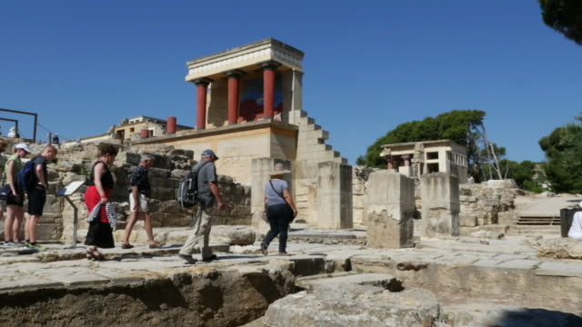 Greece Crete Knossos Minoan Civilization ruins with tourist group