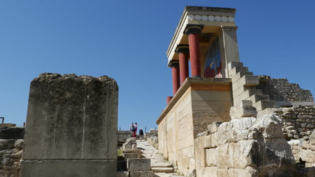 Greece Crete Knossos restored ruin side view with tourists