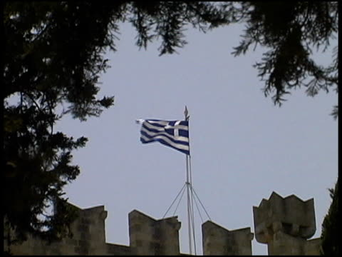 greece flag atop castle wall - letterbox format stock videos & royalty-free footage