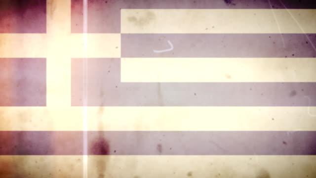 vídeos de stock e filmes b-roll de grécia bandeira de grunge retro velho filme loop com áudio - fuga de luz