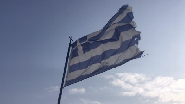 greece flag is waving against blue sky - greek flag stock videos & royalty-free footage