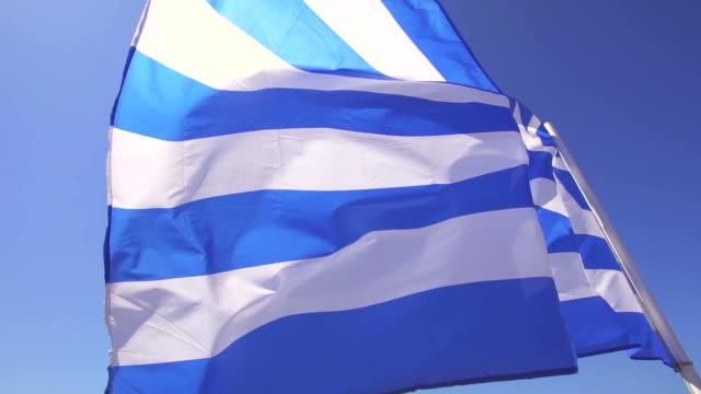vídeos de stock, filmes e b-roll de bandeira da grécia - desespero