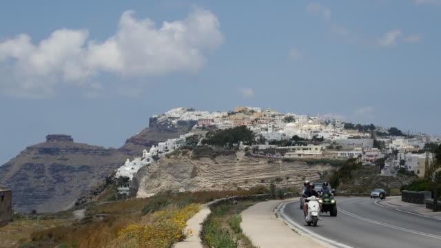Greece Santorini highway with cars and sidewalk
