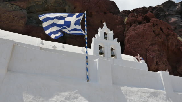 greece santorini saint nicholas church with flag flying - greek flag stock videos & royalty-free footage