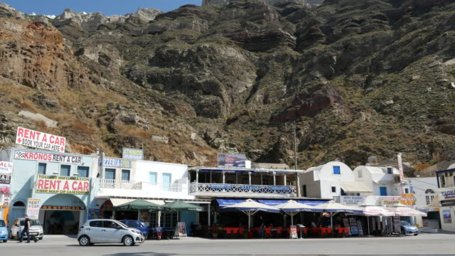 greece santorini shops and cafes under caldera rim - caldera stock videos and b-roll footage
