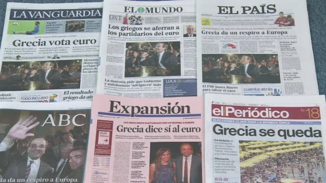 vídeos de stock, filmes e b-roll de greece votes for the euro', 'greece is still in'. clean: spanish press reports on new democracy win on june 18, 2012 in madrid, spain - desespero