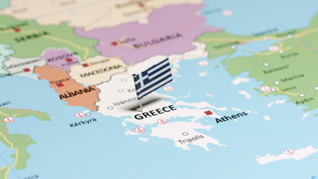 greece with national flag - greek flag stock videos & royalty-free footage