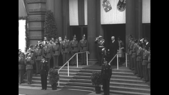 greece's king paul and wife queen frederica arrive at train station in bonn / paul shakes hands with chancellor konrad adenauer president theodor... - convertible top stock videos & royalty-free footage