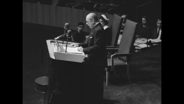 Greece's King Paul standing at podium delivers speech to United Nations General Assembly his wife Frederica sitting in chair to his right he...