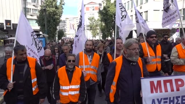 vídeos de stock, filmes e b-roll de greece's largest public sector union staged a rally in central athens on wednesday to demand an end to pension cuts and tax rise the rally being... - política e governo