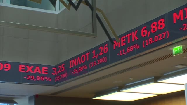 greece's stock exchange reopens with a drop of more than 22 percent after a fiveweek shutdown imposed by the country's debt crisis and capital... - grecia stato video stock e b–roll