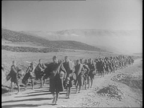 Greek army captures Coriza from Italian forces and capture 28000 prisoners of war / Greeks seize ammunitions and gasoline / Greek army cheering /...