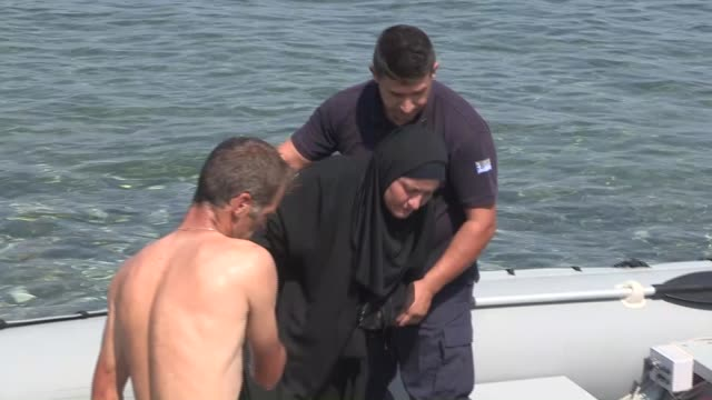 greek coast guard arrive with survivors of a capsized boat carrying refugees on the shore of lesbos island greece on september 20 2015 - capsizing stock videos & royalty-free footage