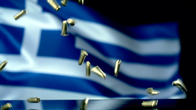 greek flag behind bullets falling in slow motion - greek flag stock videos & royalty-free footage